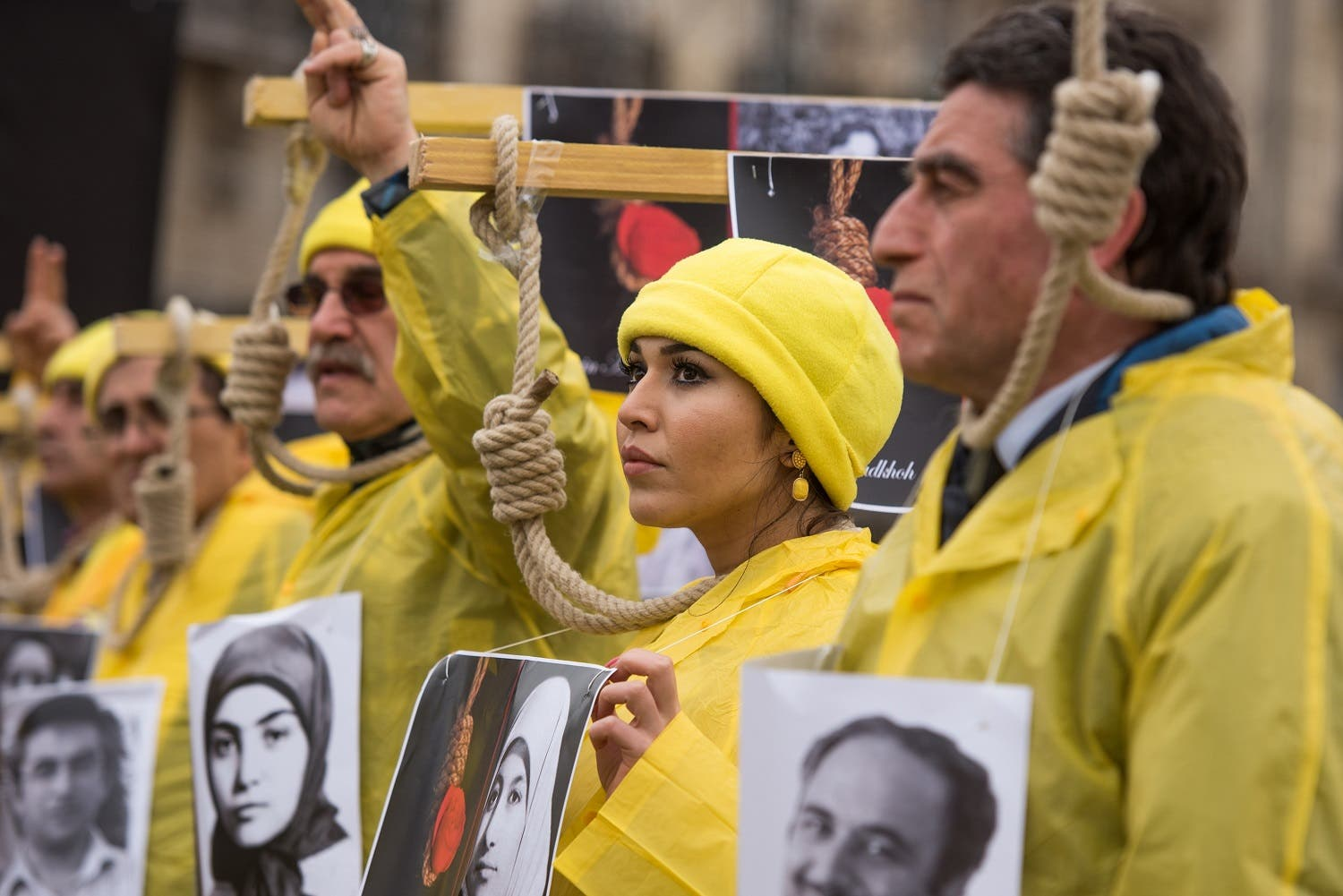 Iranian opposition protesters march during a rally to protest against executions in Iran, as Iranian President Hassan Rouhani is in France for a two-day official visit, in Paris, on Jan. 28, 2016. (AP)