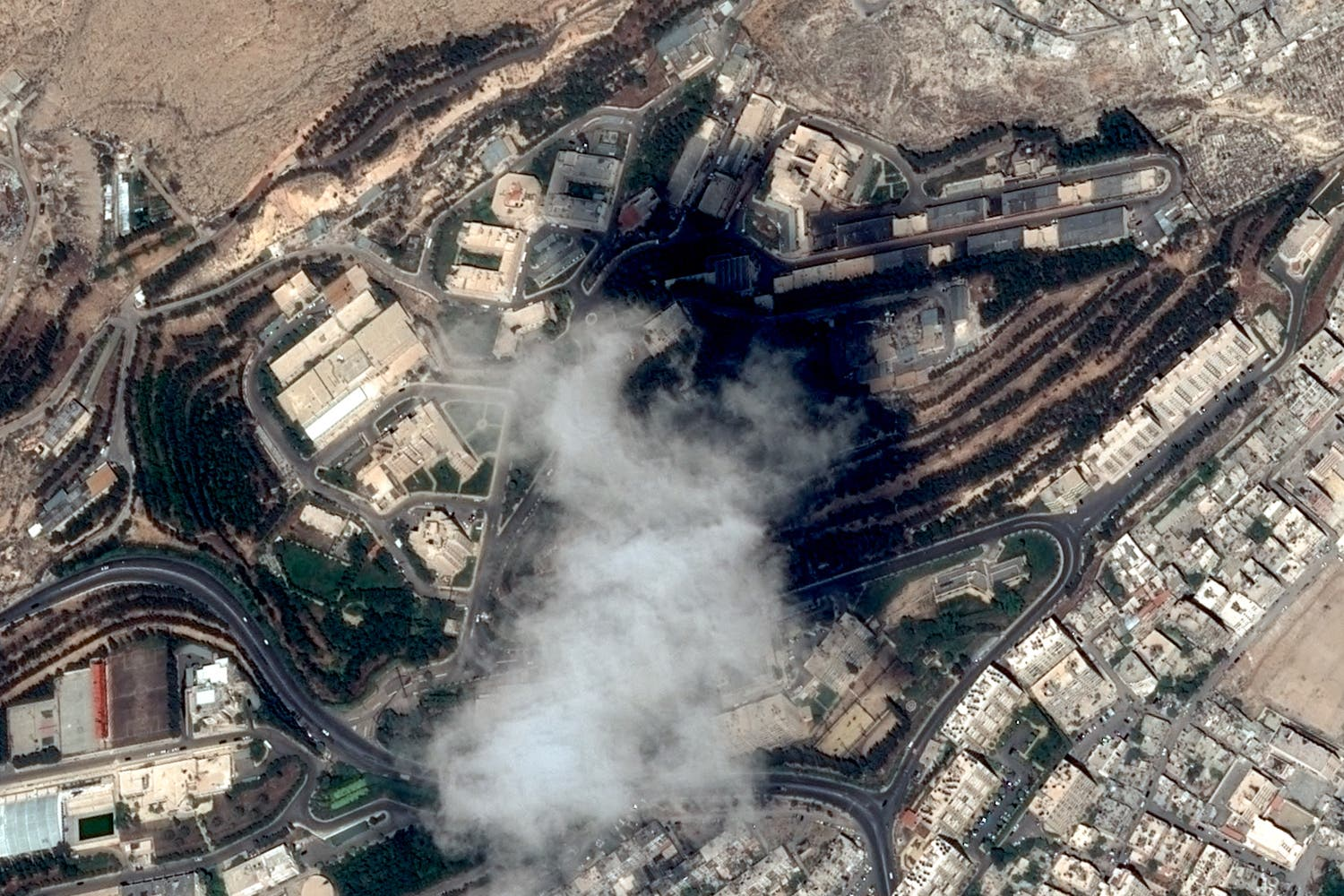 Satellite image taken on April 11, 2018 shows the SSRC compound in Barzeh district, north of Damascus, before the raids by the US, Britain and France. (AFP)