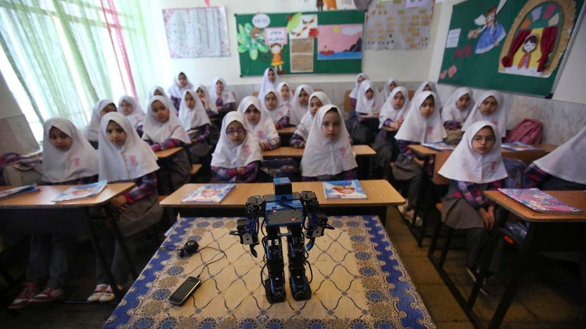 Veldan, a humanoid praying robot which is built by Iranian schoolteacher Akbar Rezaie, performs morning prayer in front of Alborz elementary school girls in the city of Varamin some 21 miles (35 kilometers) south of the capital Tehran. (AP)