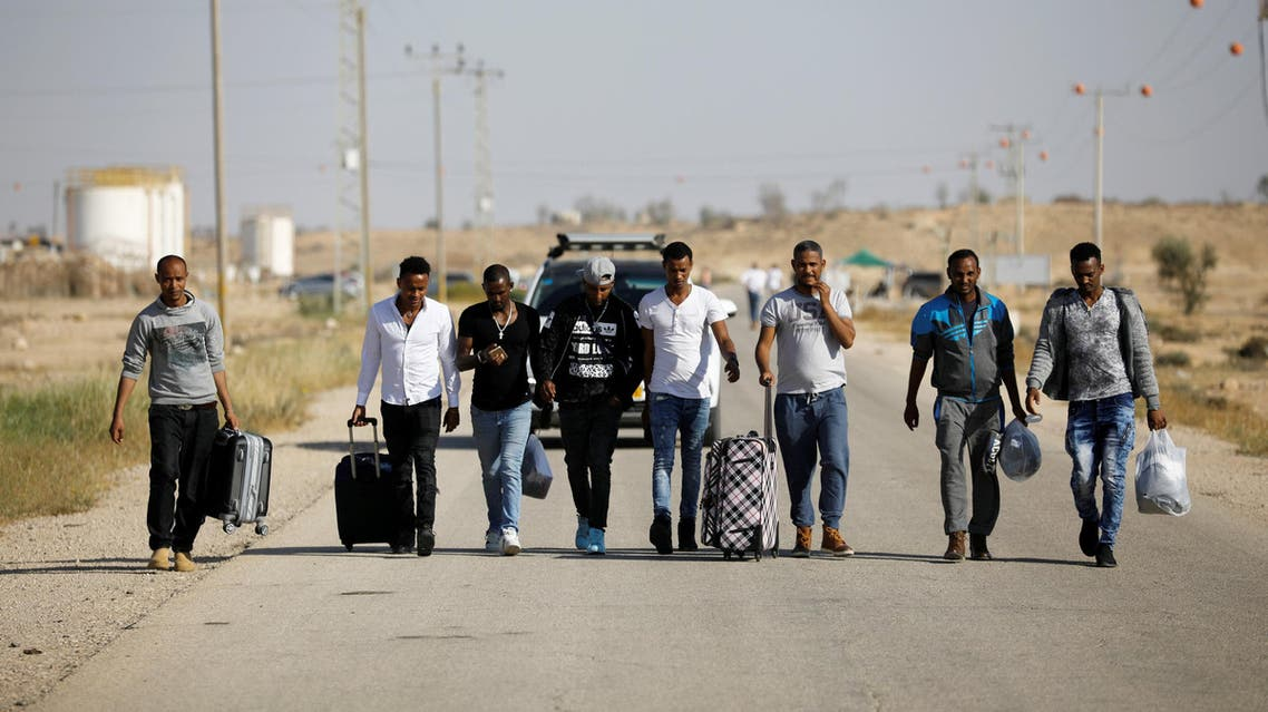 African migrants walk on a road after being released from Saharonim Prison in the Negev desert, Israel, on April 15, 2018. (Reuters)