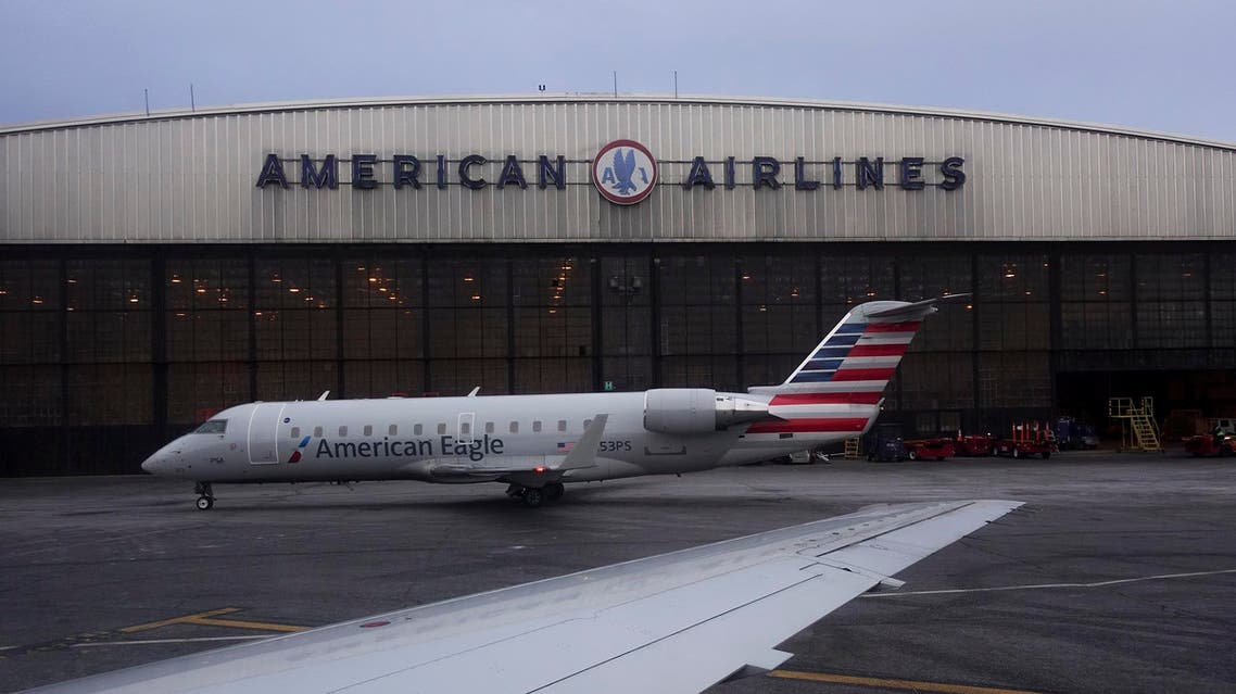 Operations proceed outside the American Airlines facilities at LaGuardia Airport on March 12, 2018, in New York. (AP)