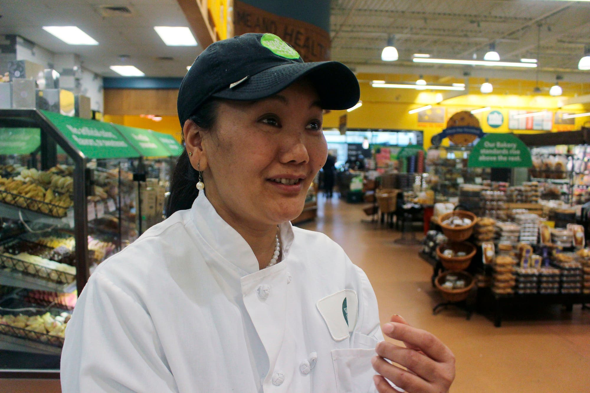In this April 3, 2018, photo, Lhakpa Sherpa prepares to start her shift as a dishwasher at the Whole Foods Market in West Hartford, Conn. (AP)