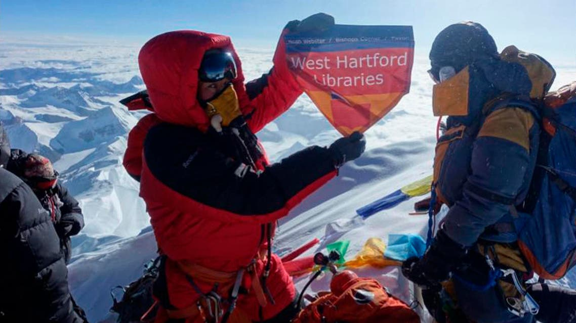 In this May 2017 photo, Sherpa displays a flag from West Hartford, Conn., on the summit of Mount Everest in Nepal. (Courtesy of Lhakpa Sherpa via AP)