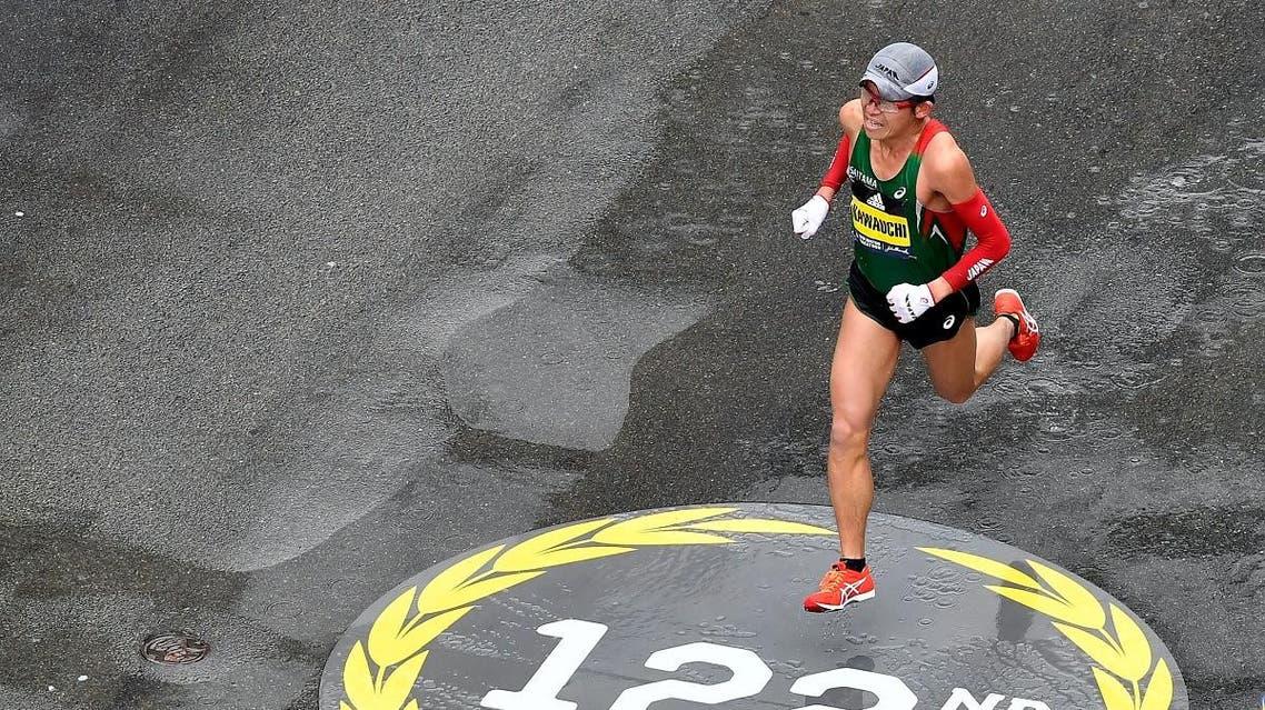 Yuki Kawauchi runs down Boylston Street towards the finish of the 2018 Boston Marathon. (Reuters)