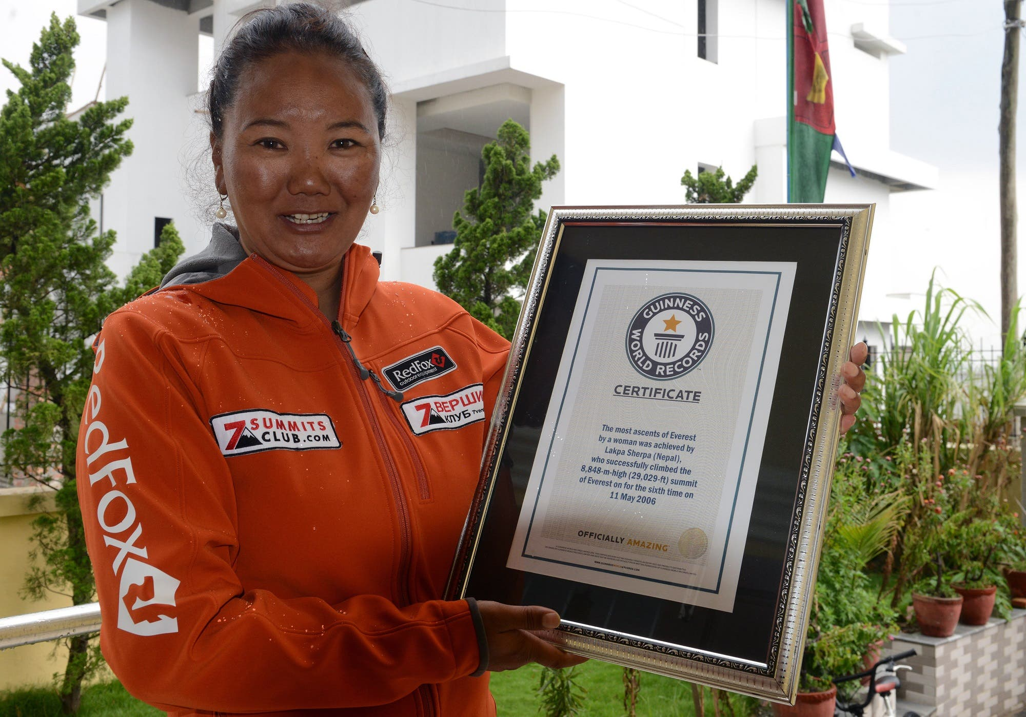 Lhakpa Sherpa poses with her Guinness record certificate in Kathmandu on May 27, 2016. (AFP)