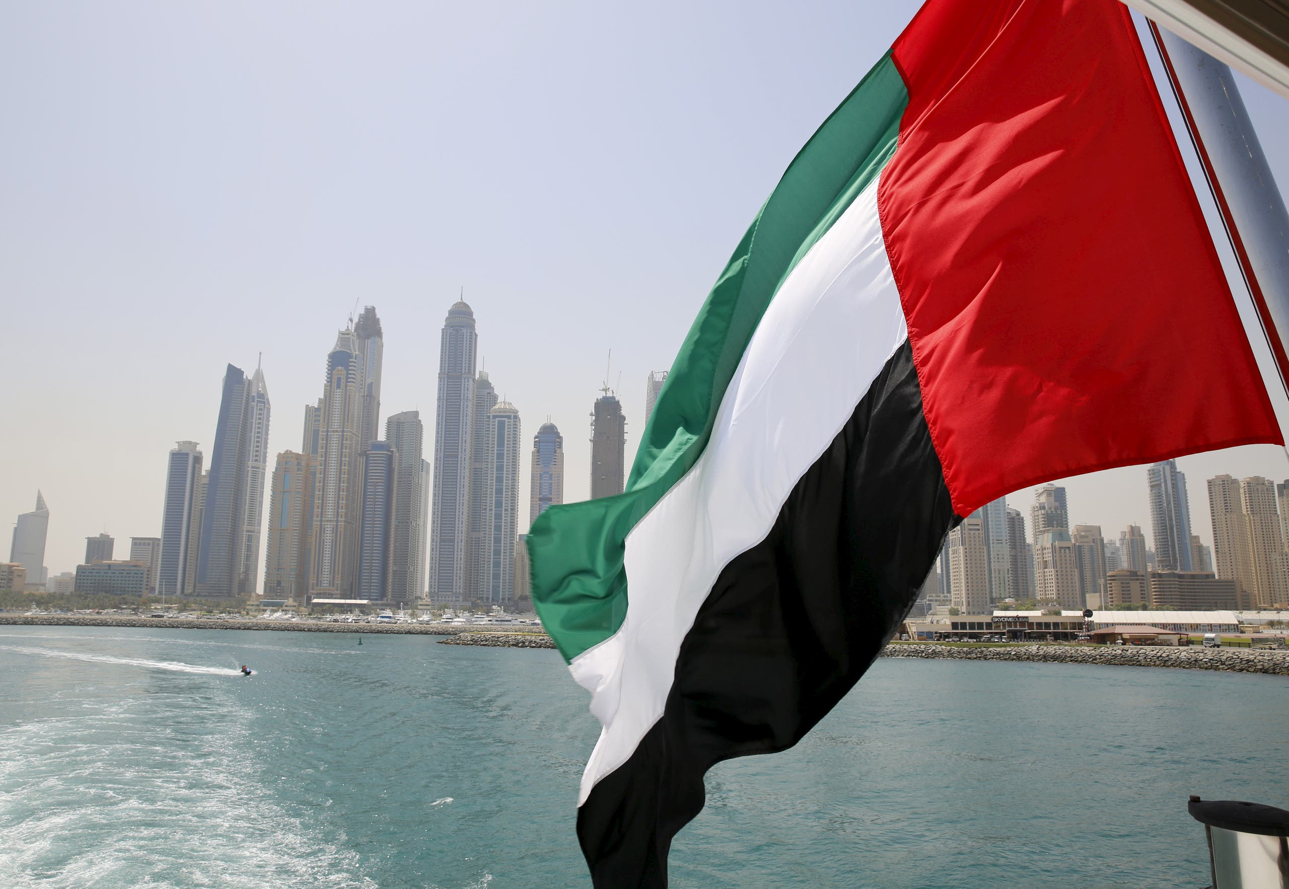 UAE flag flies over a boat at Dubai Marina, Dubai, United Arab Emirates May 22, 2015. (Reuters)