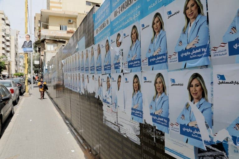 A picture taken on April 3, 2018 shows campaign posters, for the upcoming Lebanese parliamentary election, hanging in the Tariq Jedideh district of Beirut. (AFP)