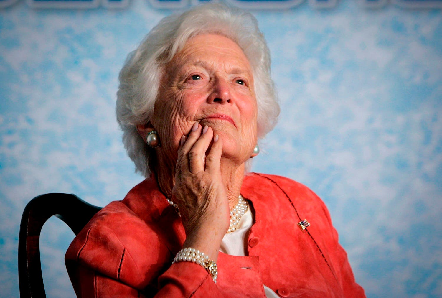 In this file photo from Friday, March 18, 2005, former first lady Barbara Bush listens to her son, President George W. Bush, as he speaks on Social Security reform in Orlando, Fla. (AP)