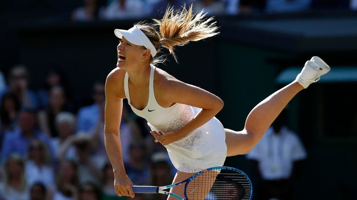 Maria Sharapova of Russia returns a shot to Serena Williams of the United States, during the women's singles semifinal match at the All England Lawn Tennis Championships in Wimbledon, London, Thursday July 9, 2015. (AP)