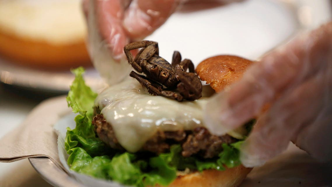 A tarantula burger is prepared at Bull City Burger and Brewery in celebration of Exotic Meat Month in Durham, North Carolina, U.S. April 16, 2018. Picture taken April 16, 2018. REUTERS/Jim Urquhart