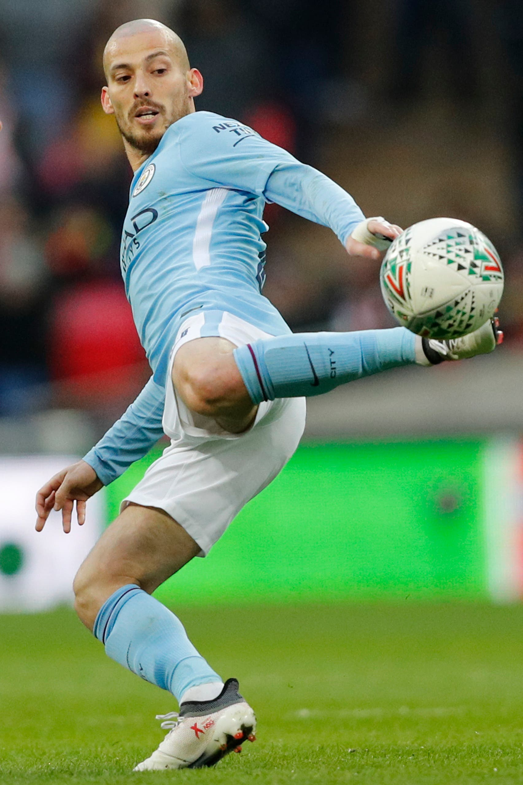 Manchester City's Spanish midfielder David Silva controls the ball during the English League Cup final football match between Manchester City and Arsenal on February 25, 2018. (AFP)