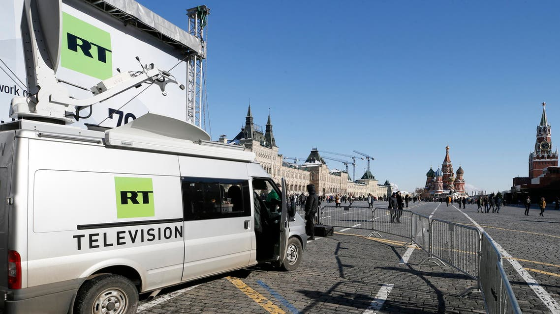 Vehicles of Russian state-controlled broadcaster Russia Today (RT) are seen at Red Square in central Moscow, Russia March 18, 2018. REUTERS/Gleb Garanich/File Photo