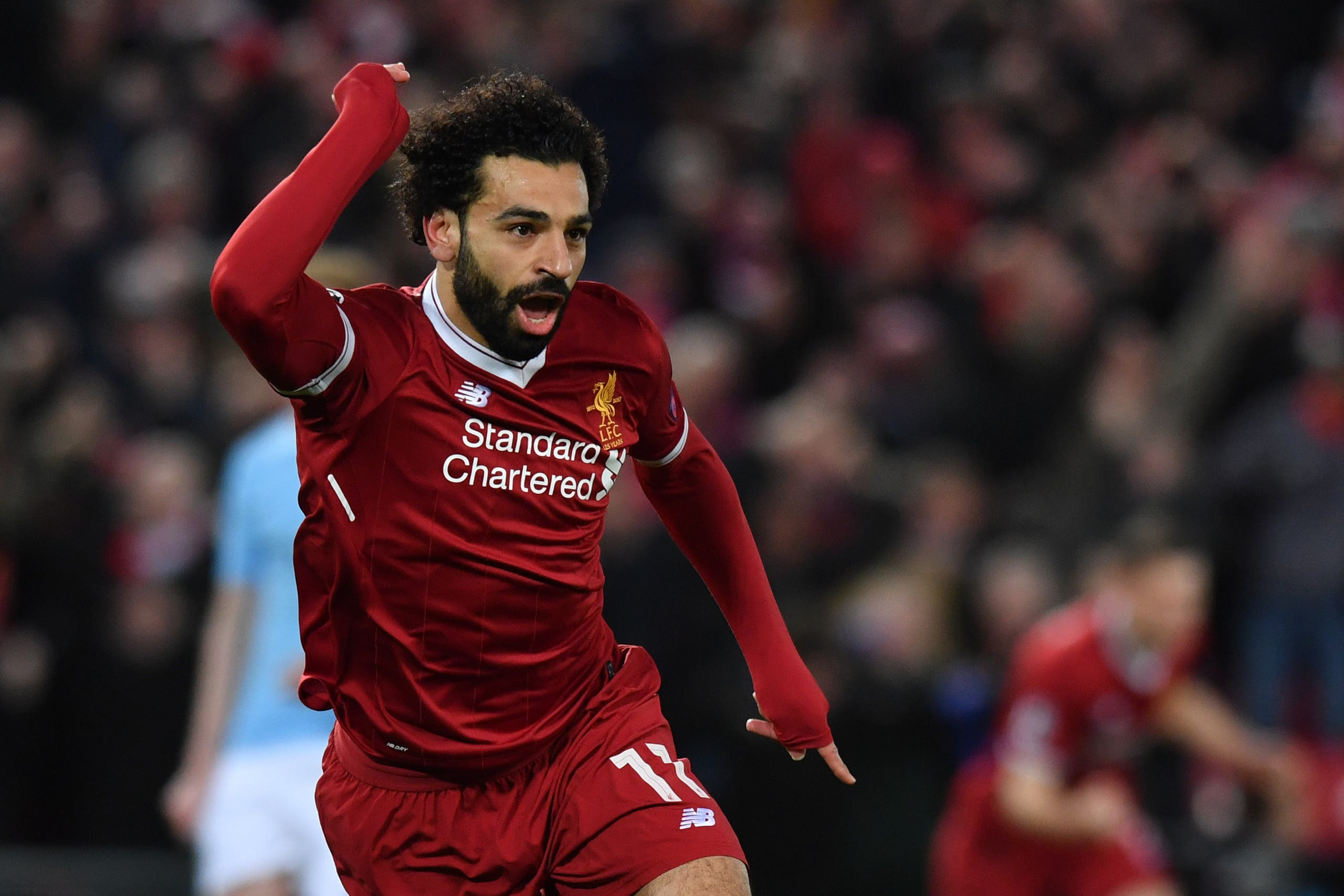 Liverpool's Egyptian midfielder Mohamed Salah celebrates scoring the opening goal during the UEFA Champions League first leg quarter-final football match between Liverpool and Manchester City on April 4, 2018. (AFP)