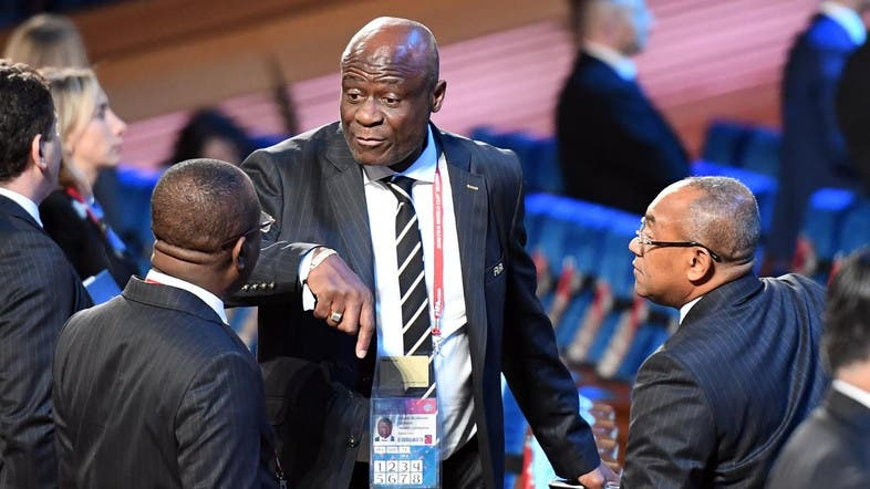 169ae77d4 FIFA Council member Constant Omari Selemani (center) speaks with guests  ahead of the 2018 FIFA World Cup football tournament final draw at the  State Kremlin ...