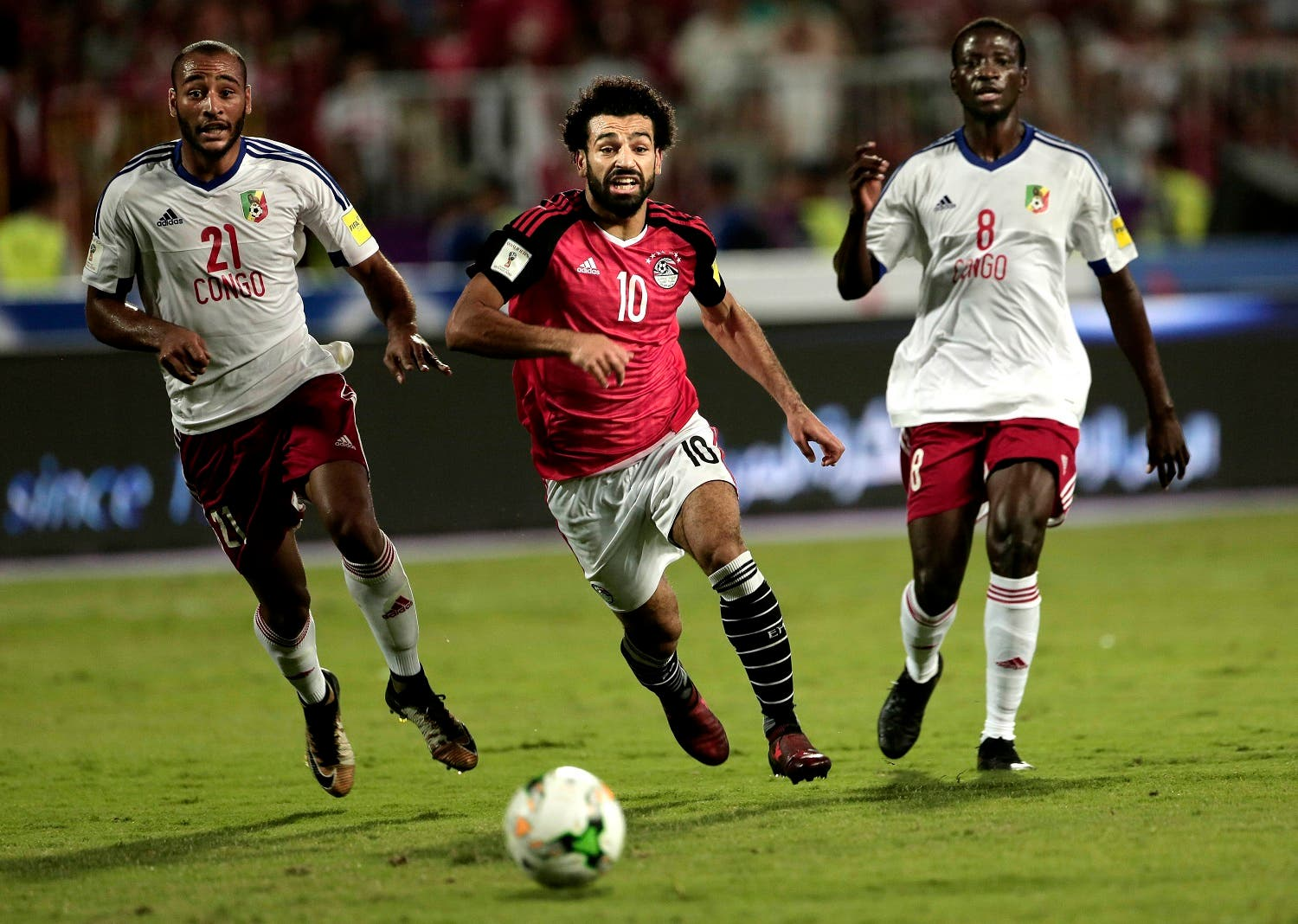 Egypt's Mohamed Salah, (center), battles for the ball with Congo's Delvin N'Dinga, (right), and Tobias Badila during the 2018 World Cup group E qualifying soccer match at the Borg El Arab Stadium in Alexandria, Egypt. (AP)