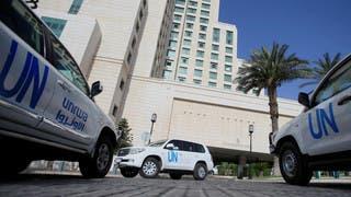 حافلات الأمم المتحدة التي تقل خبراء منظمة حظر الأسلحة الكيمياوية في دمشق