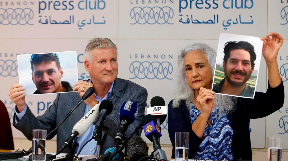 Marc and Debra Tice, the parents of Austin Tice, who has been missing in Syria since August 2012, hold up photos of him during a news conference, at the Press Club, in Beirut, Lebanon. (File photo: AP)