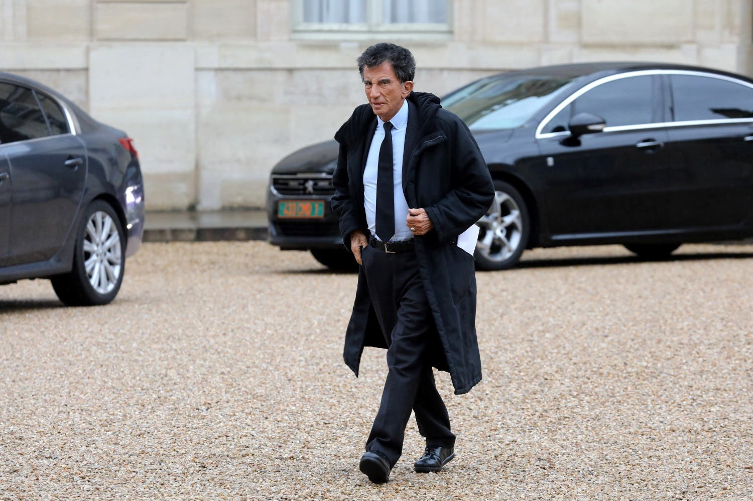 President of the Arab World Institute (IMA) Jack Lang arrives to attend a New Year wishes ceremony at the Elysee palace in Paris on January 4, 2018.  (AFP)