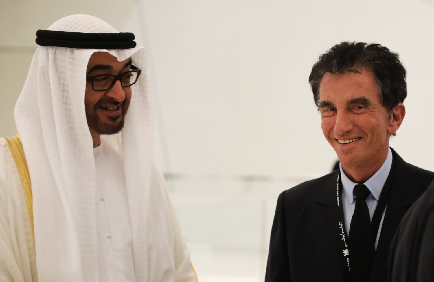 Jack Lang (R), speaks with Abu Dhabi Crown Prince Mohammed bin Zayed Al-Nahyan as they visit the Louvre Abu Dhabi Museum on November 8, 2017 during its inauguration on Saadiyat island in the Emirati capital.  (AFP)