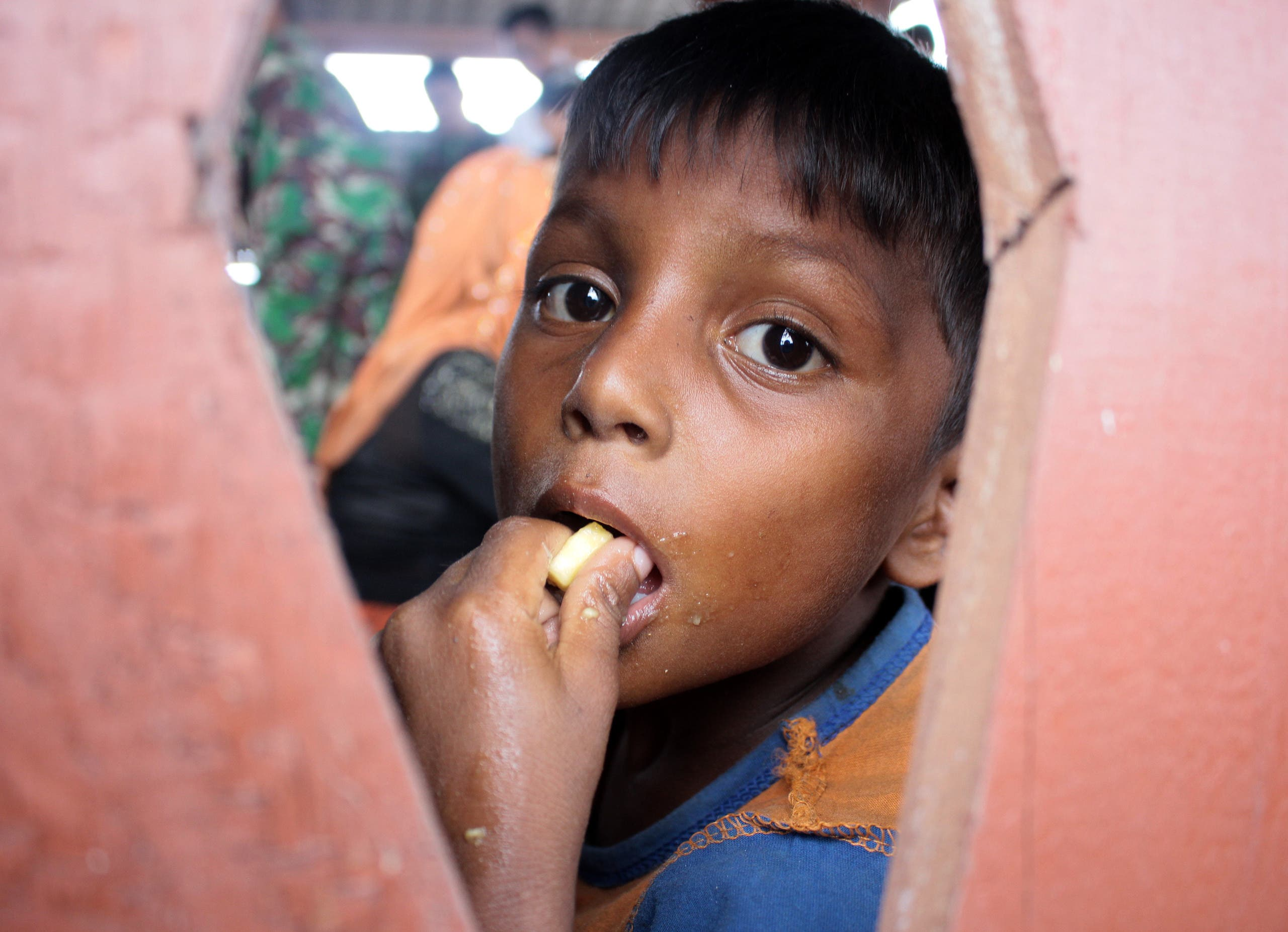 A Rohingya boy eats in a temporary shelter after he and a group of refugees landed in Aceh province on Sumatra island on April 20, 2018, just weeks after dozens of the persecuted Muslim minority from Myanmar came ashore in neighbouring Malaysia. About 80 Rohingya in a wooden boat arrived in Indonesia on April 20, officials said, the latest batch of the vulnerable minority to come ashore in the world's biggest Muslim majority nation. Amanda JUFRIAN / AFP