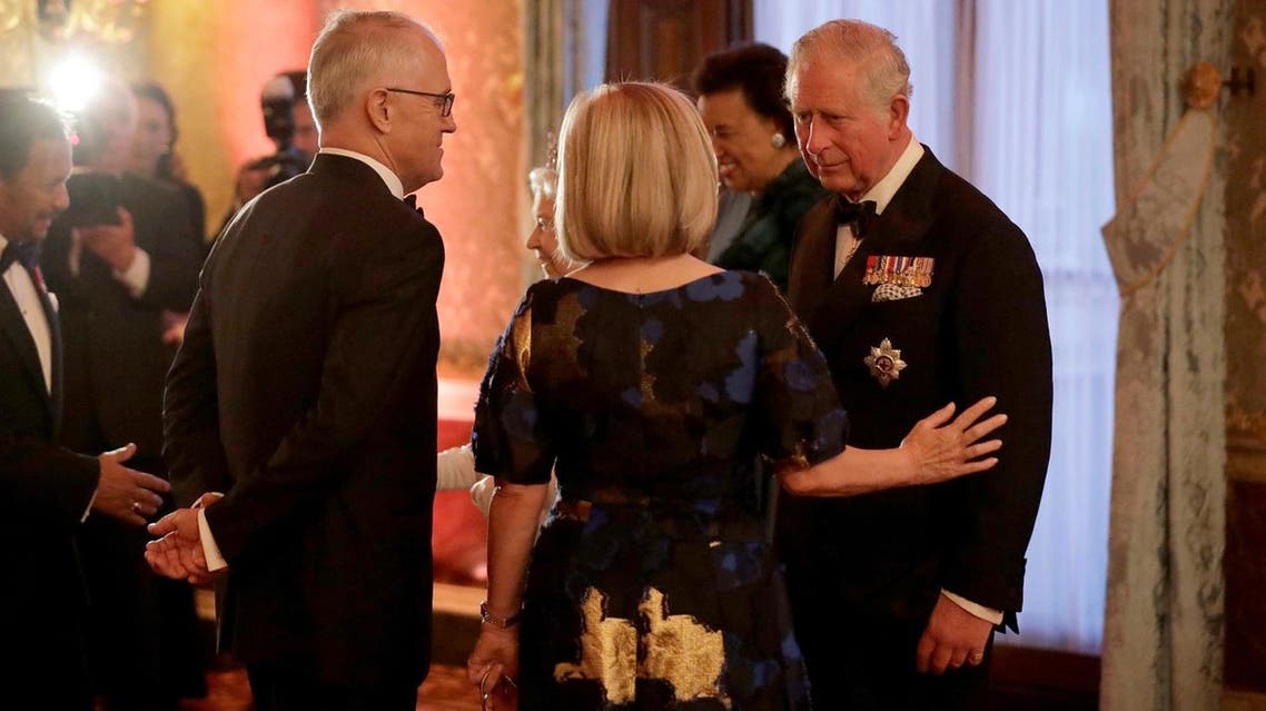 Prince Charles greets Australian Prime Minister Malcolm Turnbull and his wife Lucy in a receiving line for the Queen's Dinner for the Commonwealth Heads of Government Meeting (CHOGM) at Buckingham Palace in London, on April 19, 2018. (Reuters)