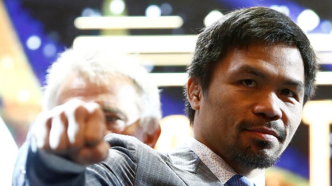 Philippine boxing icon Manny Pacquiao poses for photographers during a news conference in Kuala Lumpur. (Reuters)