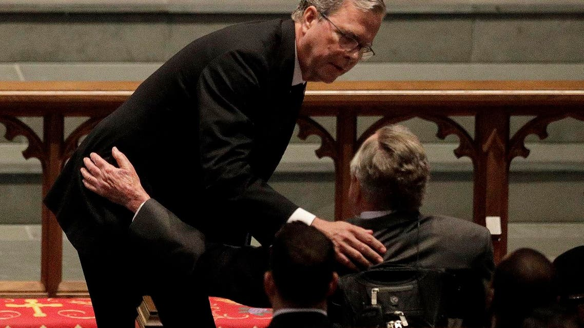 Former Florida Governor Jeb Bush comforts his father, former President George H.W. Bush during a funeral service for his mother, former first lady Barbara Bush. (AP)