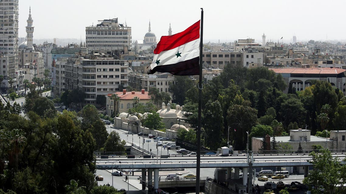 A Syrian flag flutters in Damascus on April 20, 2018. (Reuters)