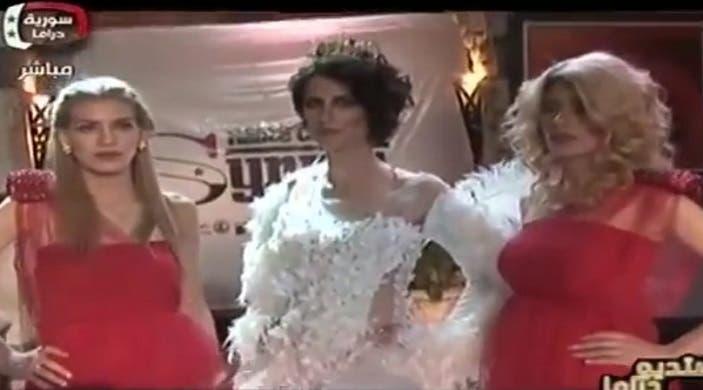 الفستانان الفائزان بعرض الأزياء
