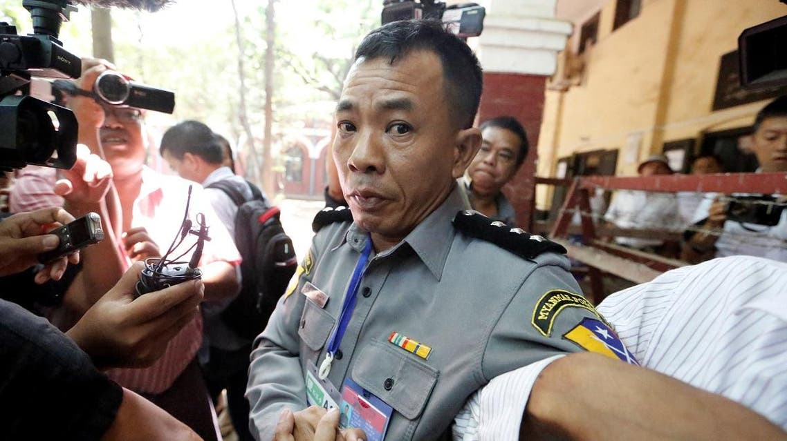 Prosecution witness police captain Moe Yan Naing walks outside the court room during a hearing of detained Reuters journalists Wa Lone and Kyaw Soe Oo in Yangon. (Reuters)