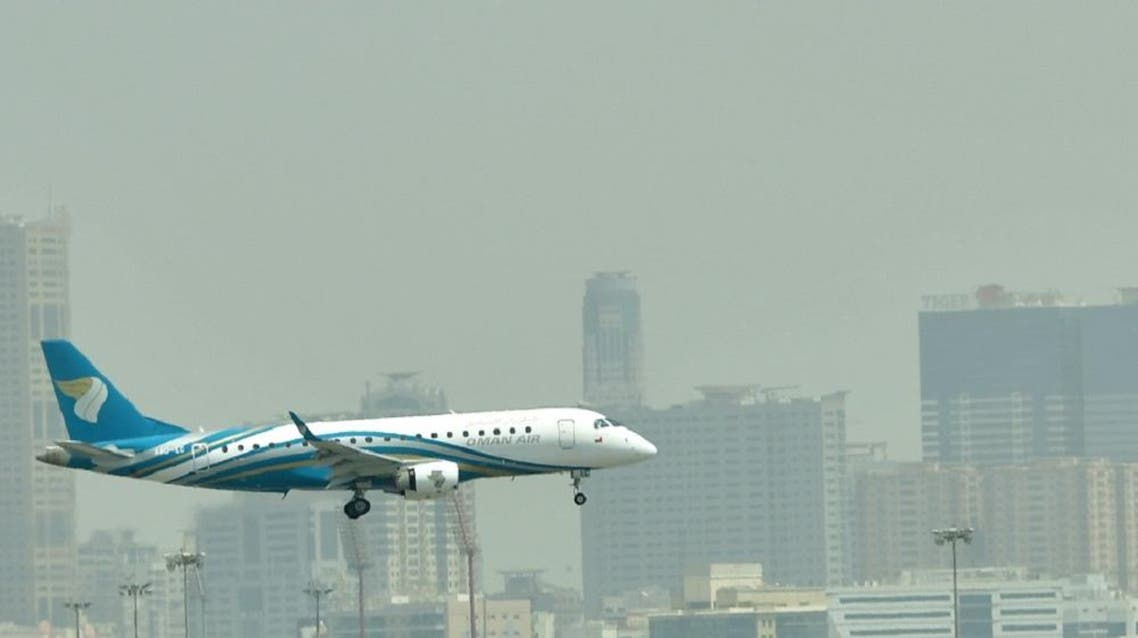 A file picture shows a Oman air plane landing at at Dubai's International Airport. (AFP)