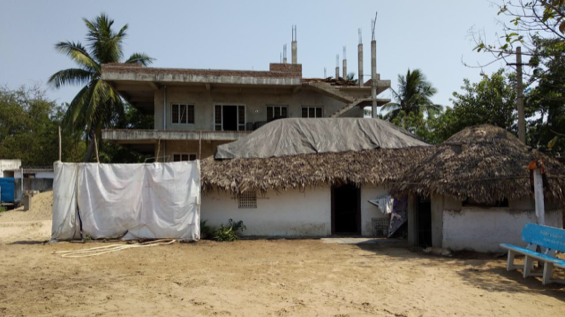 """Ragala's thatched house in Stuartpuram, """"village of criminals"""", where he grew up. (Supplied)"""