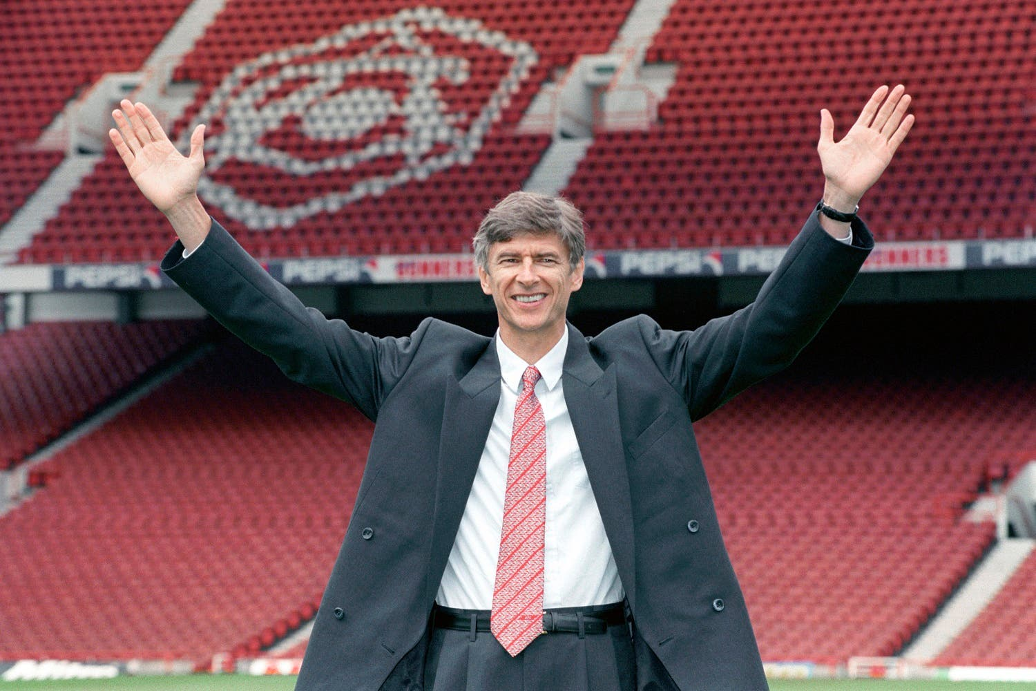 In this Sept. 22, 1996 file photo new Arsenal manager Arsene Wenger gestures following a press conference at Highbury Stadium, London. (AP)