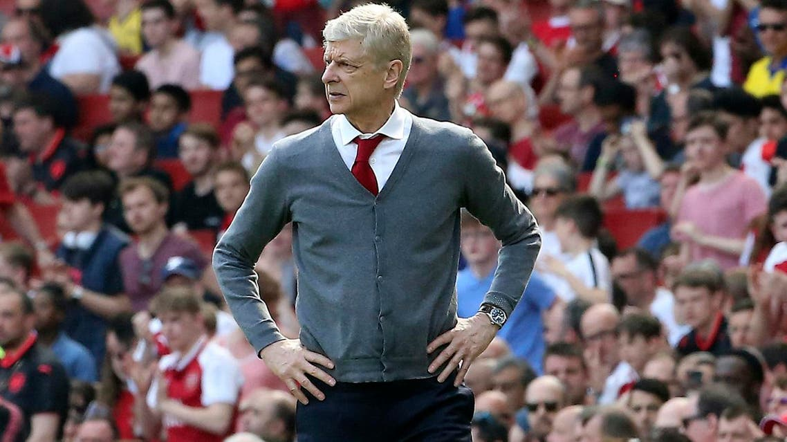 Arsenal's Arsene Wenger watches the English Premier League soccer match against West Ham United at the Emirates Stadium, London, on April 22, 2018. (AP)