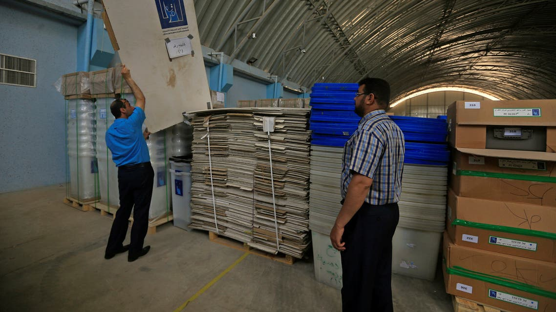Employees of Iraqi Independent High Electoral Commission inspect voting materials at a warehouse in Najaf, Iraq, April 18, 2018. REUTERS/Alaa Al-Marjani