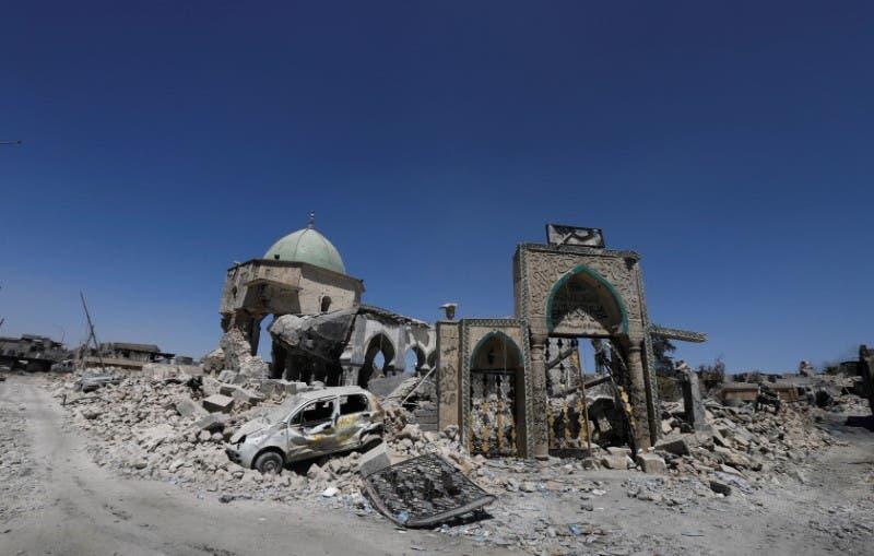 مسجد النوري أنقاضاً بعدما فجره داعش (فرانس برس)