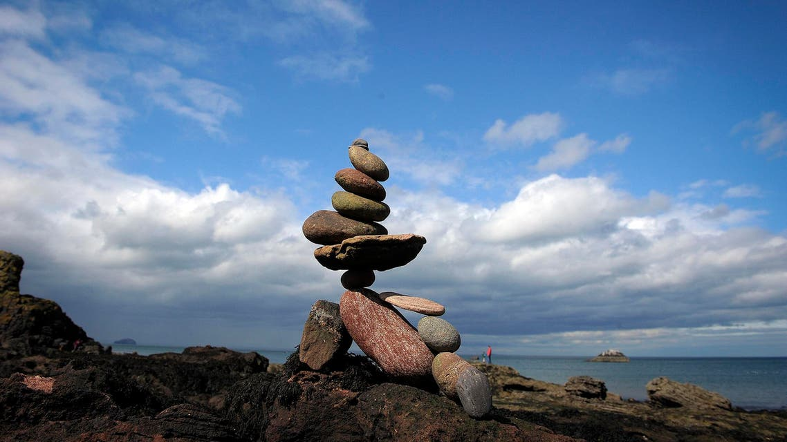 Stacked stones are pictured during the European Stone Stacking Championships 2018 in Dunbar on April 22, 2018. (AFP)