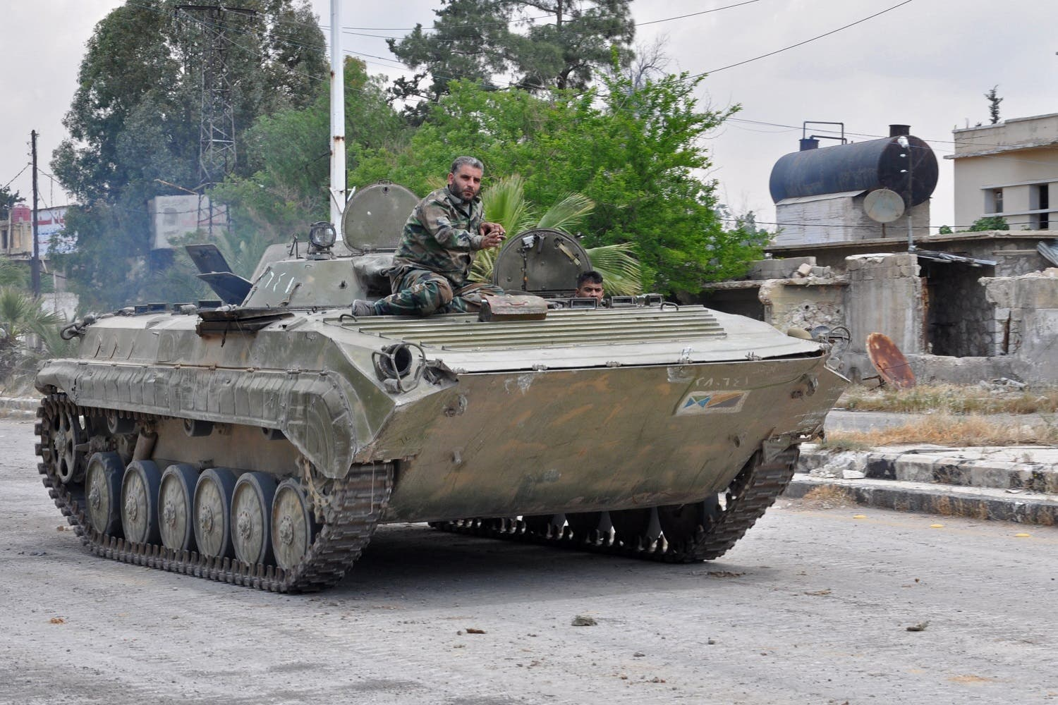 Syrian government soldiers drive an armored personal vehicle in Al Ḩajar al Aswad, on April 22, 2018, during a regime offensive targeting ISIS in the southern districts of Damascus. (AFP)