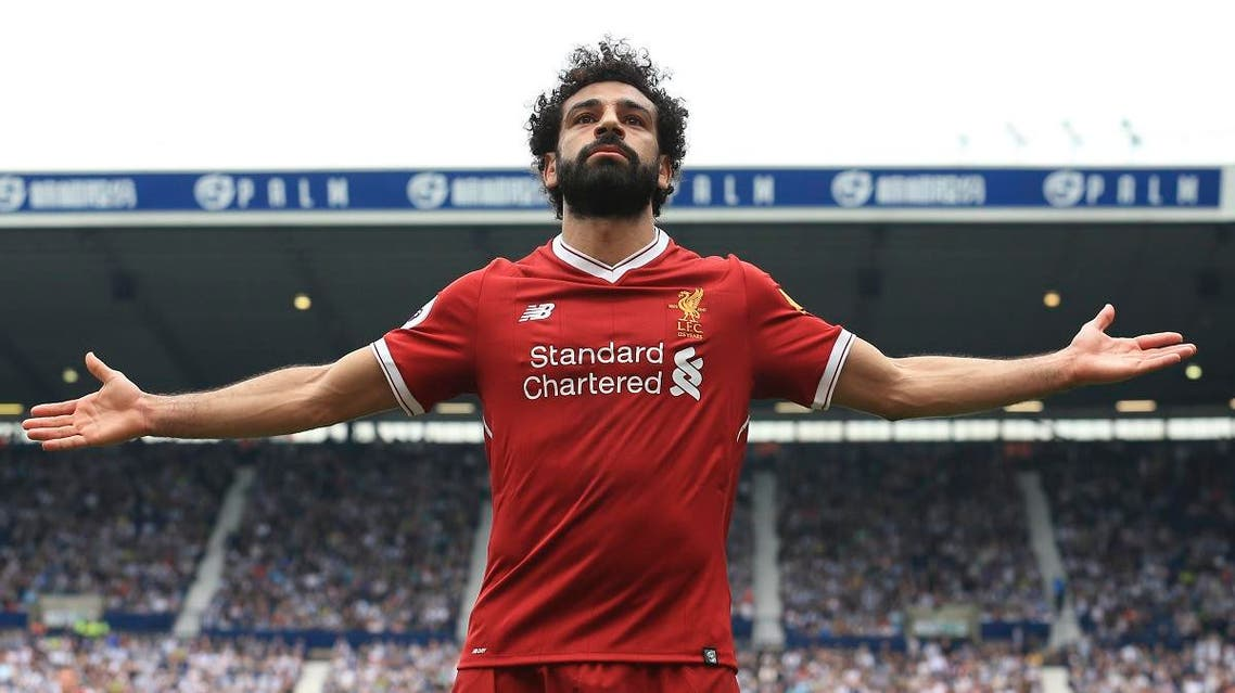 Liverpool's Egyptian midfielder Mohamed Salah celebrates scoring their second goal during the English Premier League football match against West Bromwich Albion. (AFP)