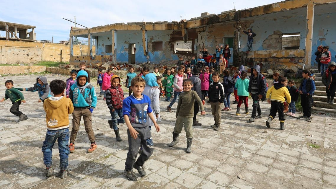 Syrian children play outside their destroyed school in the Frikeh village, in Idlib's rebel-held Western countryside on February 18, 2018.