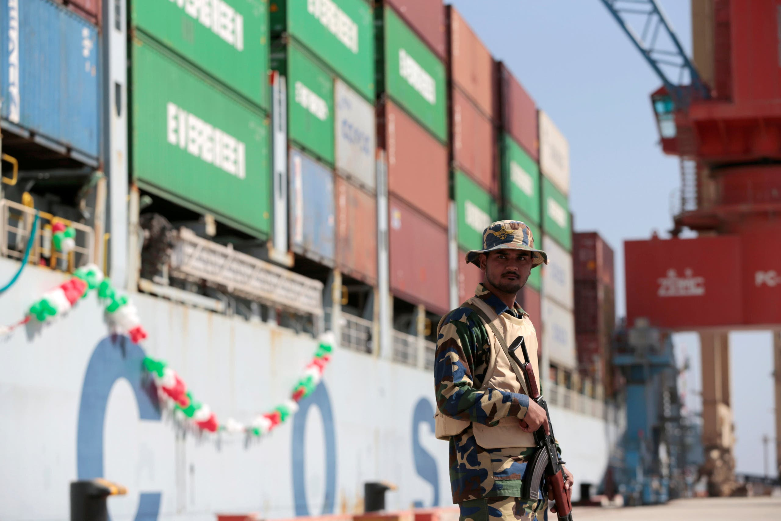 A soldier stands guard beside Cosco Wellington, the first container ship to depart after the inauguration of the China Pakistan Economic Corridor port in Gwadar on November 13, 2016. (Reuters)