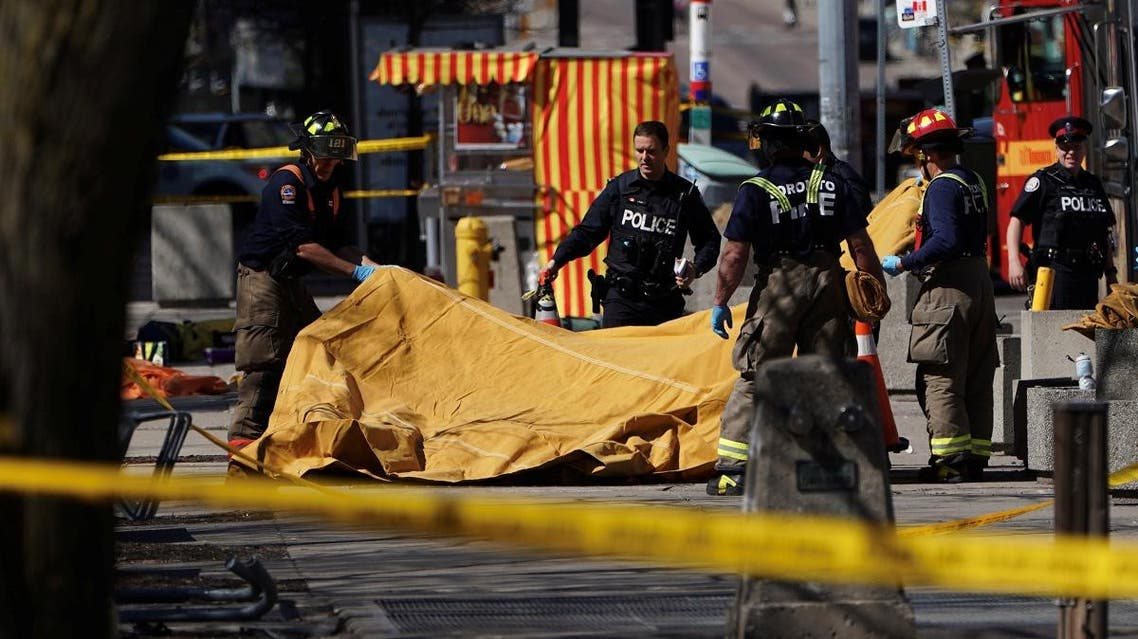 Firemen cover a victim of an incident where a van struck multiple people at a major intersection in Toronto's northern suburbs. (Reuters)