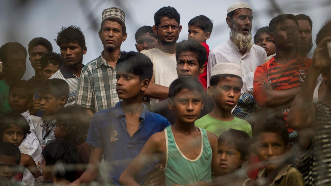 "Rohingya refugees gather in the ""no man's land"" behind Myanmar's boder lined with barb wire fences in Maungdaw district, Rakhine state bounded by Bangladesh on April 25, 2018. Myanmar government said on April 15, it repatriated on April 14 the first family of Rohingya out of some 700,000 refugees who have fled a brutal military campaign, a move slammed by a rights group as a PR stunt ignoring UN warnings that a safe return is not yet possible. (AFP)"