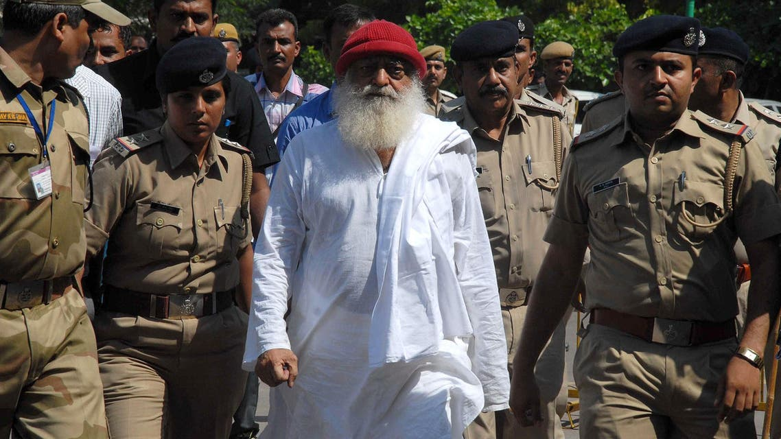 Asaram Bapu (C) is escorted by police in Jodhpur on October 14, 2013. (AFP)