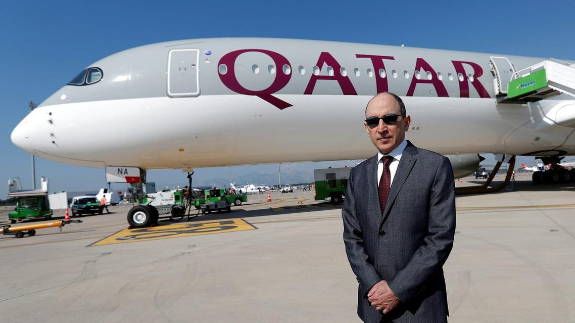 Qatar Airways Chief Executive Officer Akbar al-Baker poses in front of an Airbus A350-1000 at the Eurasia Airshow in the Mediterranean resort city of Antalya, Turkey, on April 25, 2018. (Reuters)