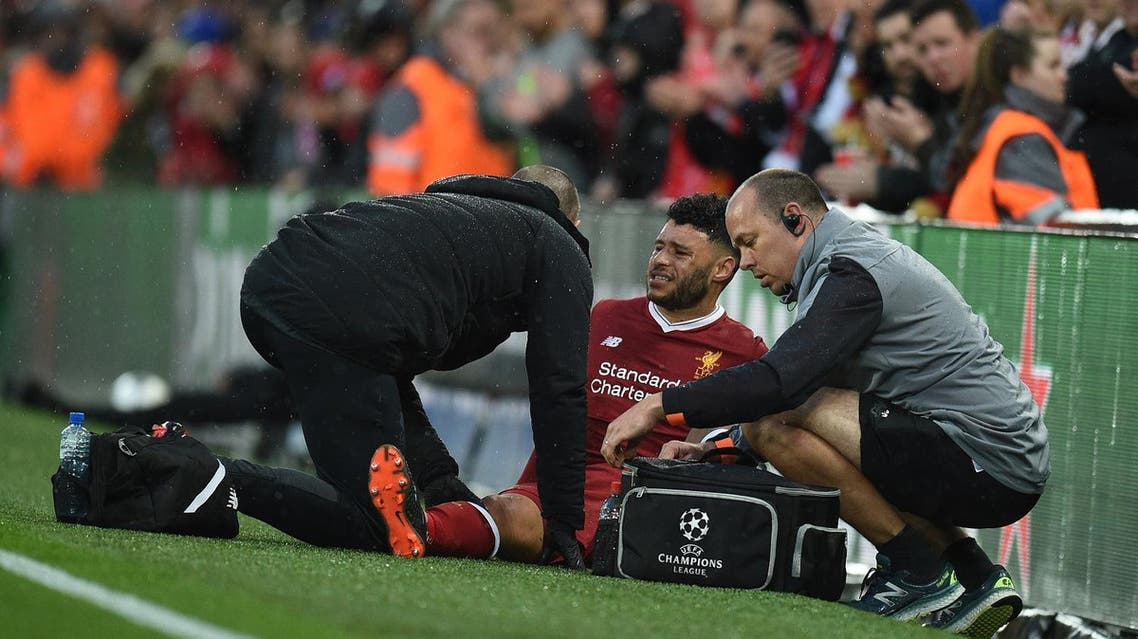 Liverpool's English midfielder Alex Oxlade-Chamberlain (C) picks up an injury during the UEFA Champions League first leg semi-final football match against Roma at Anfield stadium in Liverpool, north west England on April 24, 2018. (AFP)