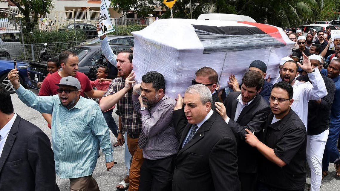 People carry the coffin with the body of Palestinian man Fadi al-Batsh, who was shot to death, to a mosque for a special prayer in Kuala Lumpur. (Reuters)