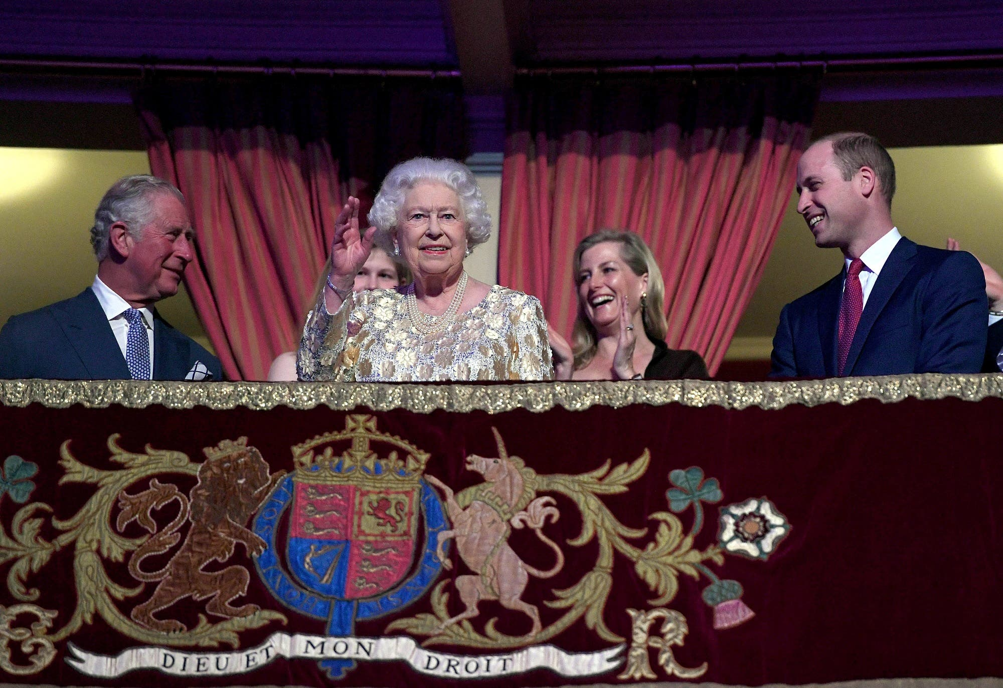 Queen Elizabeth waves next to Prince Charles and Prince William during a special concert to celebrate her 92nd birthday at the Royal Albert Hall in London on April 21, 2018. (Reuters)