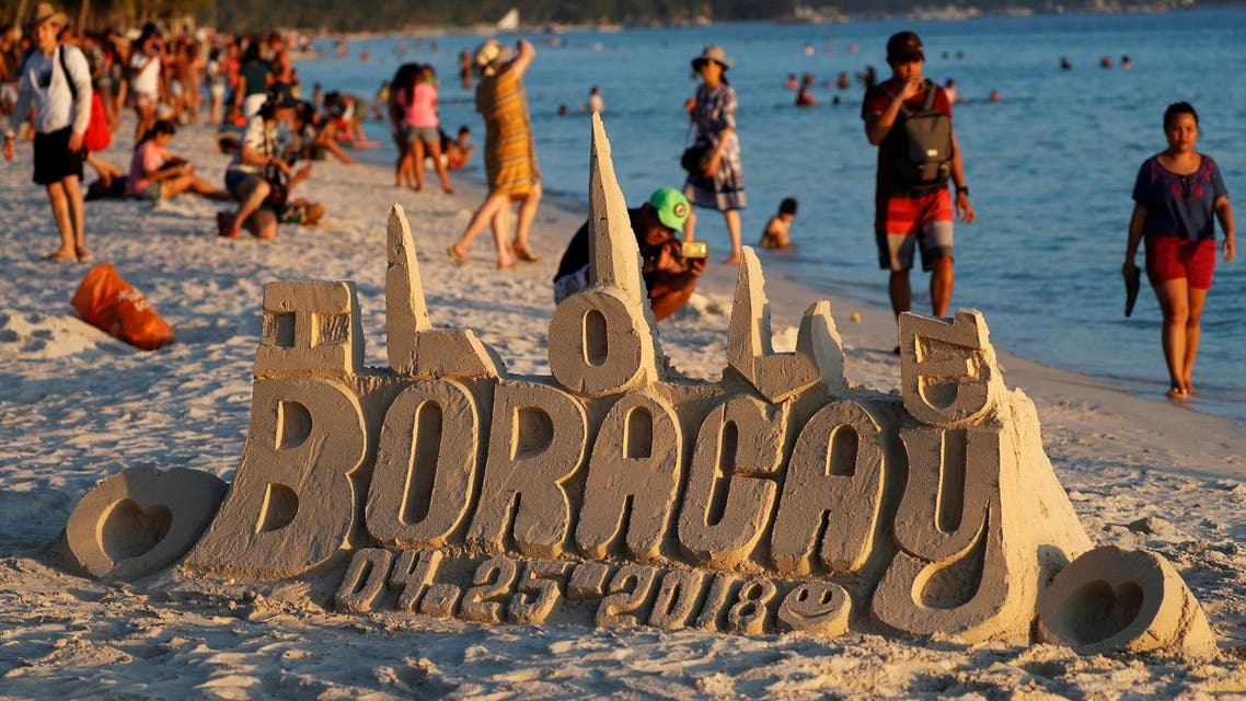 A sand sculpture is seen along the beach, a day before the temporary closure of the holiday island Boracay, in the Philippines. (Reuters)