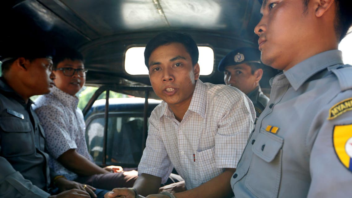 Detained Reuters journalist Kyaw Soe Oo and Wa Lone are transported in a police vehicle after a court hearing in Yangon, Myanmar April 20, 2018 . REUTERS/Ann Wang